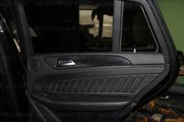 фото по перетяжке двери авто кожей